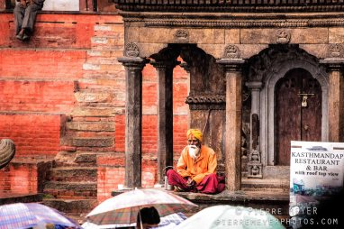 Sadhu on umbrellas